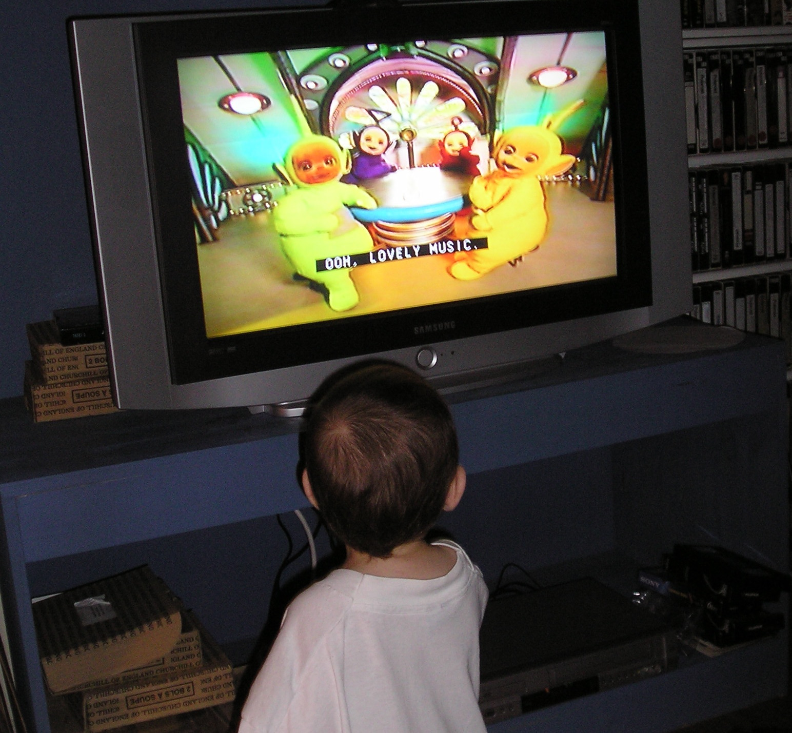 Child watching the teletubbies on TV