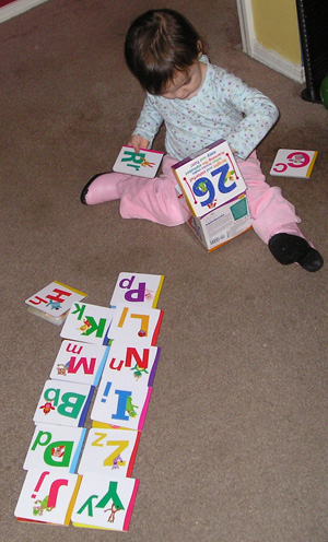 Child playing with alphabet books