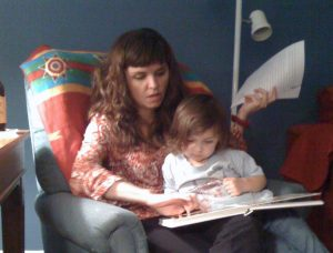 Mother reading to child.